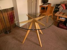 Excellent Round Glass Dining Table With Sturdy Tapered Wooden Base, Contemporary Glass Table Ideas With Interesting Table Base Design: Furniture