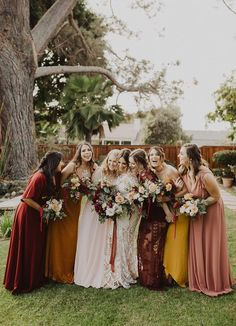 We love these autumnal hue bridesmaid gowns   Image by Gabriel Conover Whimsical Wedding Inspiration, Wedding Photography Inspiration, San Diego Wedding Photographer, Destination Wedding Photographer, Calumet Park, Mixed Bridesmaid Dresses, Red Bouquet Wedding, Red Wedding, Boho Beach Wedding