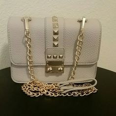 BCBG Studded Crossbody New with tags BCBG light grey crossbody with gold studs and chain BCBG Bags Crossbody Bags