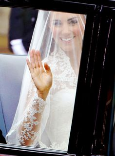 Miss Catherine Elizabeth Middleton waves to the well-wishers along the route as she and her father, Michael Middleton, are driven in a Rolls Royce from The Goring Hotel to Westminster Abbey.