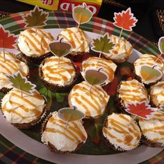 Apple spice cupcakes with apple pie filling in the middles and buttercream frosting with a caramel drizzle and autumn leaves sprinkles by Ancratyne, via Flickr (no recipe)