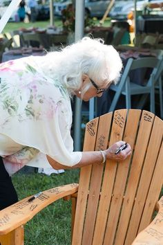 Have your guests sign an Adirondack or a plain lawn chair. That way your guestbook won't end up hidden away in storage. #guestbook #wedding #alternative #original