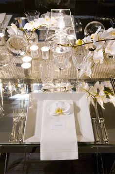 There are so many wonderful textures going on in this tablescape! We love the burlap-like runner and the glass and white china. This just proves that neutral color palettes can be glam too! #wedding #ideas #neutral #reception