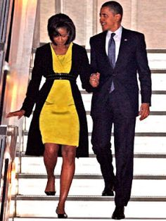 First Lady Michelle Obama wore a Jason Wu dress while arriving at London's Stansted International Airport that she accessorized with a black belt and shoes. Barack Obama, Malia Obama, Barrack And Michelle, Michelle Obama, Marjorie Harvey, Mellow Yellow, Black Love, Couple, We The People