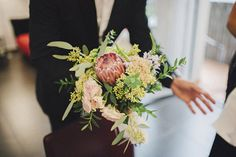 Wedding Planner: Detallerie. Ramo de novia con protea. Bouquet with protea.