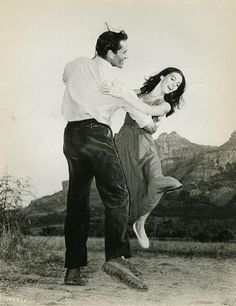 Mel Ferrer and Pier Angeli dancing in photo shoot from the movie The Vintage, 1957.