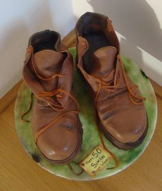 How to carve boots out of a square cake.  Follow the link through to the album.