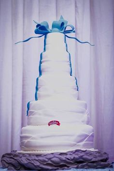 A pristine white cake topped off with a cool blue bow makes a perfect winter wonderland treat.
