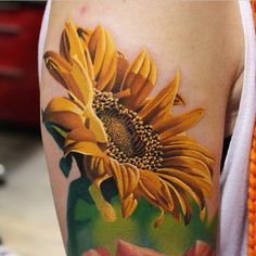 45 Bright Sunflower Tattoos Meanings and Designs for Happy life Check more at http://tattoo-journal.com/30-bright-photos-of-sunflower-tattoos/