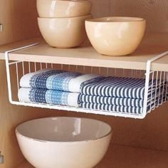 Featured Season 2 Episode 1 on Pinheads Podcast on the Life:examined Network at Southgate Media Group. - Container Store under cabinet shelf - very useful, we need a shallow one like this instead of the big ones in the laundry room