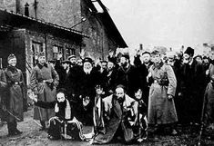 This photo shows part of the 7000 Jews deported from Lukow, Poland to the extermination camp at Treblinka. Note how the soldiers smile at their frightened, helpless captives.