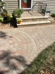 Add a paving stone walkway and stairs to your home to create a clean, welcoming entry!