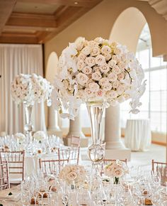ivory rose and orchid centerpiece | Victor Sizemore | blog.theknot.com