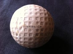 """Mesh golf ball. Dunlop Warwick Mesh golf ball - circa 1920's Has """"Warwick"""" on both poles and the number 4 in eight places. Mesh golf balls were used before dimple golf balls took over. All mesh golf balls make a valuable addition to any golf ball collection due to the history and the very interesting patterns of the mesh."""
