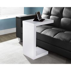 Bring sleek, modern style into your home with the White Hollow-core Accent Table. With a thick panel design and bold white finish, this table is sure to blend well with a variety of contemporary decors.