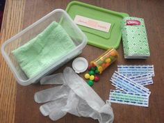 "Jesus performs miracles.  Contents of our first aid kit. Washcloth, tissues, band-aids, a glove, and ""pills"". On the lid is a sticker shaped like a band-aid that says, ""Jesus heals""."