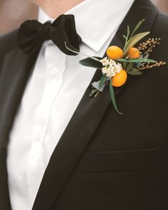 the boutonnieres // orange and citrus theme // wedding inspiration // groom style