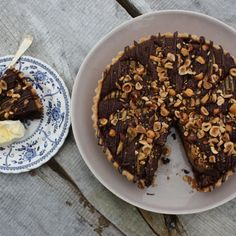 You'll want to add lashings of cream to this indulgent chocolate, pear frangipane & hazelnut tart from Lara Spurrel of Woods Cafe