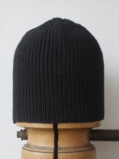 Wayside Flower hand knitted wool hat black front stand