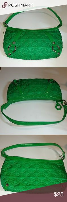 VERA BRADLEY CARLYLE BAG Brand new bright green & vibrant nylon retired vintage Vera Bradley bag.  Green quilted nylon bag with matching green patent leather trim and handle.  Silvertone hardware.  Top zip closure with round patent leather zipper pull.  Interior lining is a pretty floral print in blue, green & white.  Interior has two open slip pockets & one zip pocket. Vera Bradley Bags