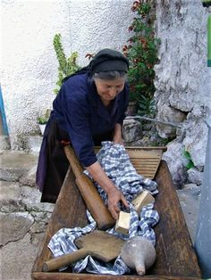 Woman washing clothes with soap made from olive oil (green soap). Stealing Beauty, Green Soap, Under The Tuscan Sun, Cultural Diversity, Athens Greece, Crete Greece, Natural World, Soap Making, Washing Clothes