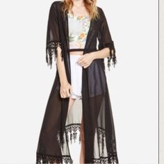 For love and lemons robe Never thought I'd be seeing this one go but I just never wear it anymore! Beautiful sheer black for love and lemons robe. Tassels on hem of bottom and sleeves. Gorgeous! Small hole on the front that is hardly noticeable. Will upload more pictures if wanted! For Love and Lemons Jackets & Coats Capes