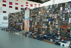 """Audio-electronic sculpture by Maubrey: recycling electronics into massive sculptures. Passersby can """"call up"""" the artpieces and speak through them. This speaker wall composed of 1000 recycled pieces doubled as a PA system during events in Angers, France."""