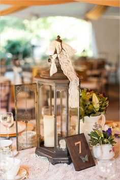 Vintage and shabby table decor and table number. #weddingreception #centerpiece #weddingchicks Captured By: AJ Dunlap ---> http://www.weddingchicks.com/2014/04/25/elegant-1920s-mansion-wedding/