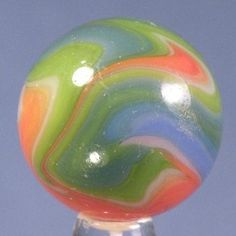 """Colorful Vitro Agate """"Parrot"""" marble."""