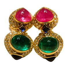Bulgari 1980s Emerald and Sapphire Earrings | From a unique collection of vintage clip-on earrings at http://www.1stdibs.com/jewelry/earrings/clip-on-earrings/ 68K USD