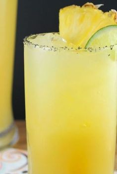 Pineapple-Margaritas | 3 cups pineapple juice, 1 3/4 cup orange juice, 2 oz fresh lime juice, 1 cup triple sec, 1 cup tequila, ice, salt for rim of glass, fresh pineapple and lime slices for garnish