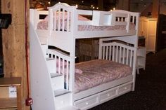 white bunk beds with stairs