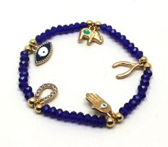 Dark Blue Crystals and Gold Plated Lucky Charms Stretch Bracelet | AyaDesigns - Jewelry on ArtFire