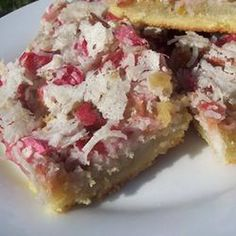 Dreaming of a different way to use rhubarb? Try these sweet bars shared by Marion Tomlinson of Madison, Wisconsin. She tops a tender shortbread-like crust with rhubarb, walnuts and coconut for delicious results. Rhubarb Desserts, Rhubarb Recipes, Just Desserts, Rhubarb Pie, Rhubarb Dream Bars, Gourmet Recipes, Dessert Recipes, Bar Recipes, Fruit Recipes