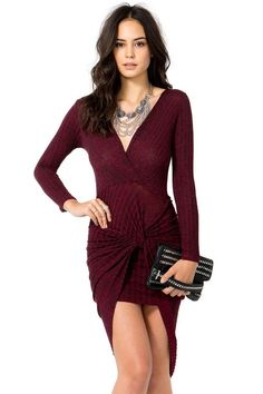 Arrive with all eyes on you in this bias-cut sweater dress, featuring a surplice neck, long sleeves and knotted front. Bodycon fit. Hi-lo hem. Finished hem. Pair it with a clutch and open toe heels. $27.90