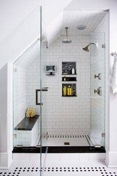 A crisp black-and-white-tiled shower, tucked under attic eaves, feels spacious. | Photo: Eric Roth | thisoldhouse.com