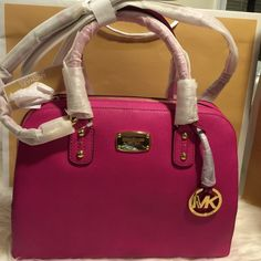"AUTHENTIC  MICHAEL KORS SAFFIANO SATCHEL LG NWT MICHAEL KORS SAFFIANO LEATHER LARGE SATCHEL/CROSSBODY HANDBAG IN FUSCHIA. STYLE: 35S3GSAS3L Saffiano leather  Top zip closure.  Double handles  Gold tone hardware, Michael Kors logo stamped on front  Hanging MK logo circle charm.  Interior: 1 zippered pocket & 4 multifunctional sleeve pockets  MK signature lining  13"" wide (at base) 10"" wide (at top) x 10"" tall x 6"" deep - size LARGE.  Removable & adjustable strap - drop 21"" - 24"".  Feet on…"