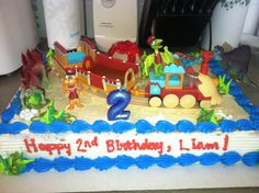 Dinosaur train birthday cake. Oreo blizzard cake with Dino decorations and piece of a dinosaur train.