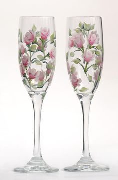 Soft pink and white rosebuds with soft green leaves hand-painted on two high quality 6 ounce champagne flutes.