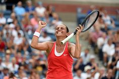 Roberta Vinci celebrates after winning over Kristina Mladenovic in a women's singles quarterfinal match during the 2015 US Open.