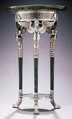 A UNIQUE EMPIRE STYLE SILVER-MOUNTED NEPHRITE GUERIDON  marked Fabergé and with the workmaster's mark of Hjalmar Armfeldt, St. Petersburg, 1908-1917 The circular dished top above a pierced lattice frieze set with three berried-laurel wreath medallions issuing fruit-filled cornucopia, on three Empire style winged female caryatid supports and tapering cylindrical legs joined by a circular undertier, on leafy paw feet, fully marked