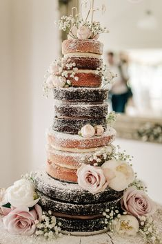 A perfect example of a naked wedding cake that tastes as good as it looks, this multi-tiered creation, made by a bridesmaids, features chocolate brownie layers with Nutella frosting and coconut sponge. vegan wedding cake Go Bare: 39 Naked Wedding Cakes Brownie Wedding Cakes, Crazy Wedding Cakes, Fruit Wedding Cake, Vegan Wedding Cake, Summer Wedding Cakes, Fondant Wedding Cakes, Floral Wedding Cakes, Wedding Cake Rustic, Wedding Cakes With Flowers
