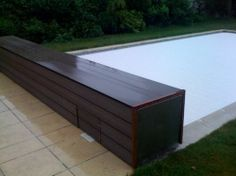 - Automatic swimming pool cover / security by COVREX