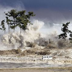 tsunami waves hitting the coast of Minamisoma in Fukushima prefecture