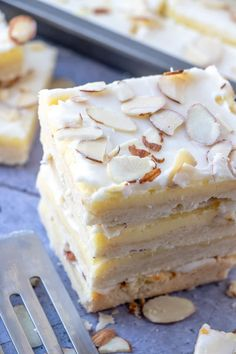 Layered with shortbread, cheesecake and glaze these Almond Cheesecake Bars are easy, addicting and the perfect dessert to satisfy your sweet tooth! Almond Recipes, Baking Recipes, Cookie Recipes, Dessert Recipes, Bar Recipes, Cheesecake Bars, Cheesecake Recipes, Apple Cheesecake, Just Desserts