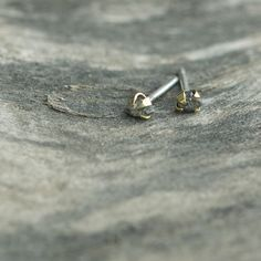Kelsey earrings in brass. Raw diamond studs with oversized claw settings. The stone is said to re-energize the wearer. Sterling silver posts. $40.