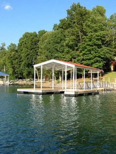 North Georgia Boat Lift & Marine Construction Company completed installation on a beautiful CAT 3 dock at Lake Chatuge, right in time for the 4th of July! Fitted with a single-slip combined with a wide-side, this dock features Ironwood decking. A gable roof protects this dock from any hail or persistant rainfall. Two 1/4″ Cables anchor the dock to shore, while a 60′ Arched Gangway anchors to shore! Dock Ideas, Backyard Renovations, Boat Lift, Gable Roof, Boat House, Boat Dock, Blue Ridge, Deck, River