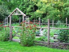 This basic garden fence may appear to be old and rustic, but you can build a brand new on with the same amount of character. Just follow the steps for a simple log style fence but don't treat the wood. Let it be and it will turn grey like this. And don't forget to add the handy chicken wire to keep out hose pesky critters.