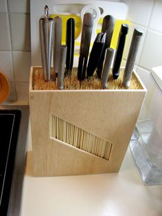 knife rack (MMB thought:  I could make a lid that could be used to put a lock on knives so to be out of children's reach when not in use!)