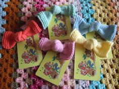 Pretty knitted knot brooches - presented on a vintage playing card. You can find them at www.theblueberrypatch.co.uk